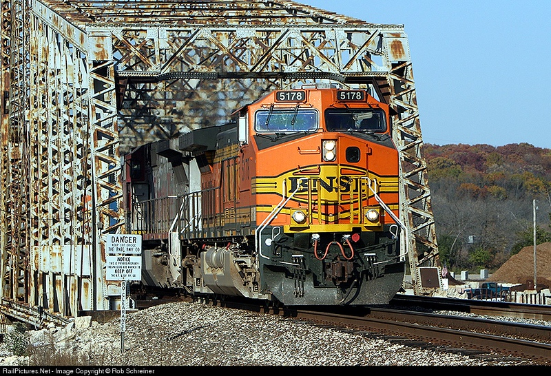 BNSF 5178 pops out of the Chicago sanitary ship canal bridge in Lemont,IL.