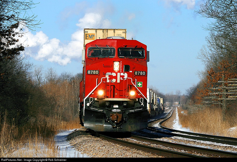 A double stack train heads towards Bensenville rounding the curve in the Van Patten forest preserves in Wadsworth, IL.