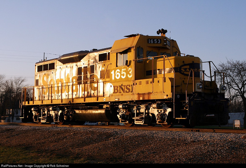 Now privately owned, this ex-Santa Fe geep glints the sunset.<br /> LaPorte County Grain Co-op