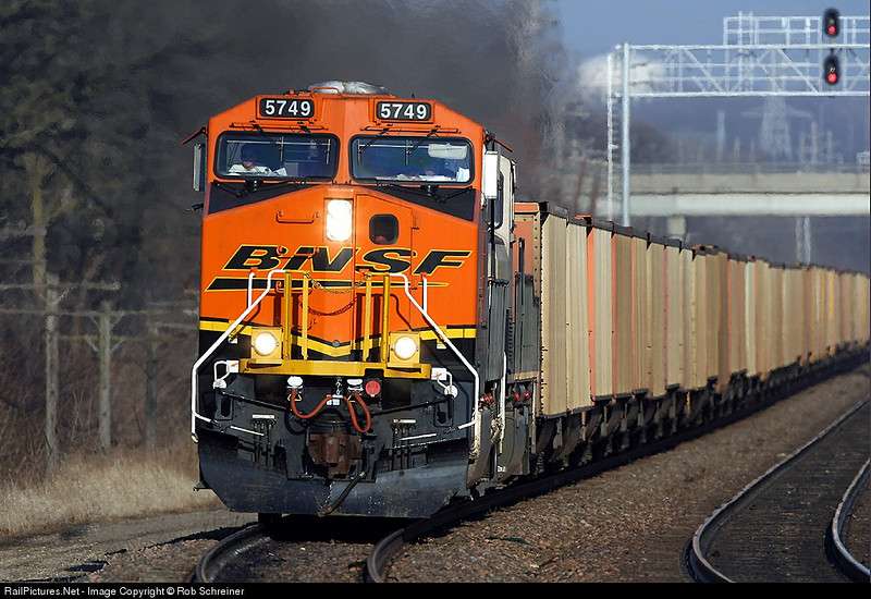 An empty coal train heads into the sun westward in Naperville, Il on the BNSF's Chicago subdivision.