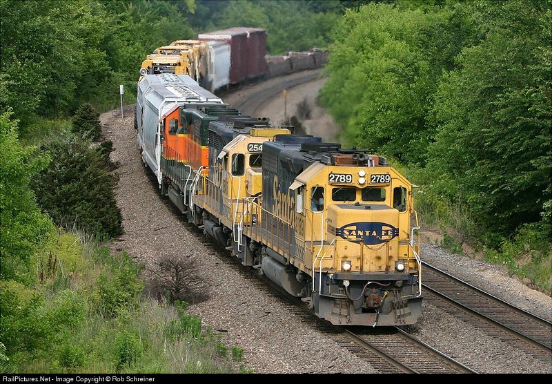 """Three EMD locomotives in """"run 8"""" drag a mixed freight up the hill at Edelstein, IL. on the old Santa Fe transcon line."""