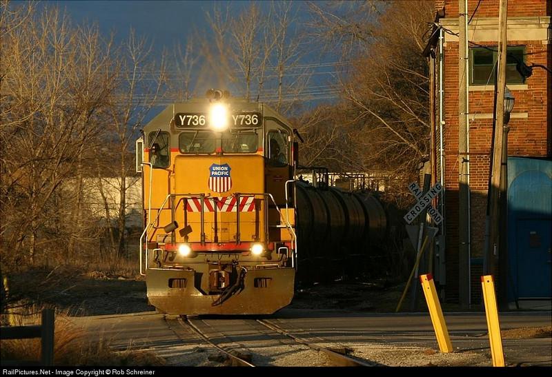 Union Pacific's LPK 42 local train heads into the setting sun in Kenosha.