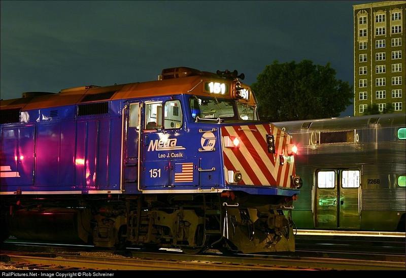 Metra locomotive 151 sits in the Waukegan coach yard overnight.