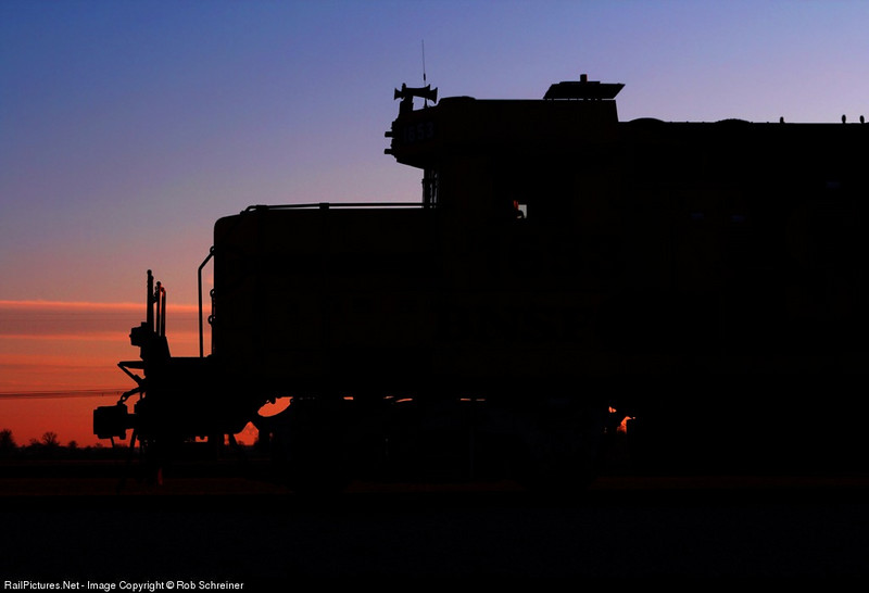 A little art... sunsets behind this private locomotive in rural Indiana.