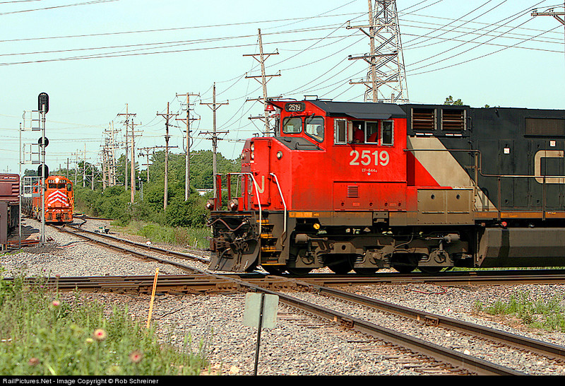 A CN train rolls south on the Waukesha subdivision as the EJ&E holds on the Western subdivision at Leithton, in Mundelein, IL.