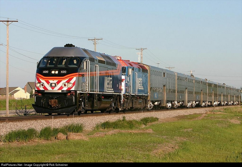 Metra express heads towards Fox Lake, IL as it runs thru Grayslake, IL.