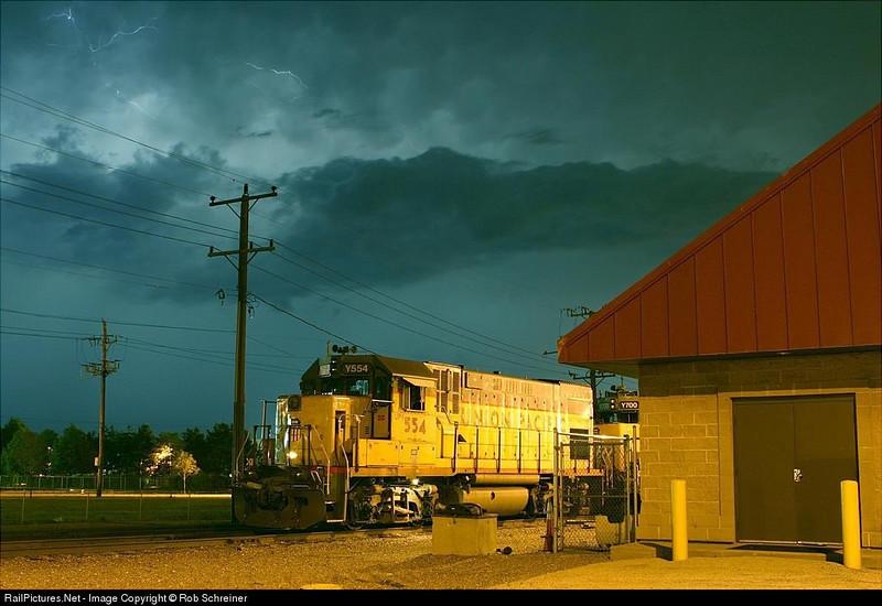 Union Pacific locomotives sit under lightning.  Waukegan, IL