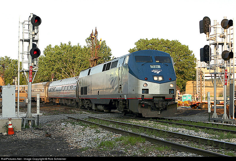 Amtrak Lincoln service train heads southbound under the semaphore signals at Brighton Park in Chicago.  This was the last train ever to pass below the historic signals.