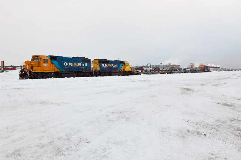 Cochrane 2010 December 21st. Locomotives with flatcars for vehicles move to couple with passenger section of Polar Bear Express at station.