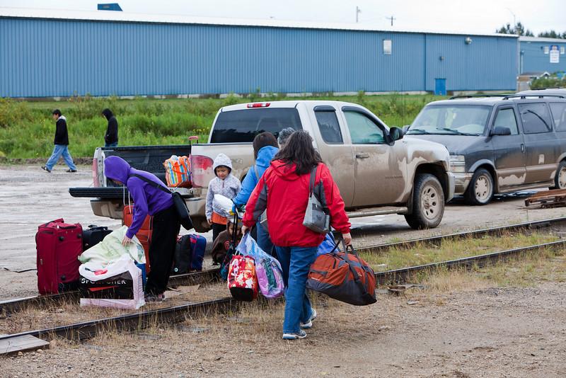 Transferring baggage to trucks from Polar Bear Express.