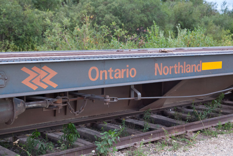 Chevron on side of Ontario Northland Railway flatcar 100502 used in Polar Bear Express service to carry vehicles (chain car)