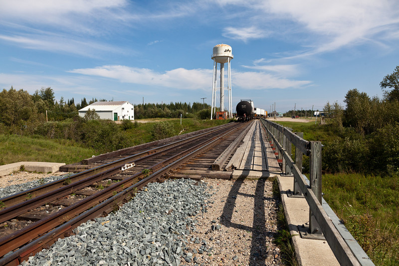 A lone tank car brings up the rear of the twice weekly Ontario Northland freight to Moosonee, Ontario.