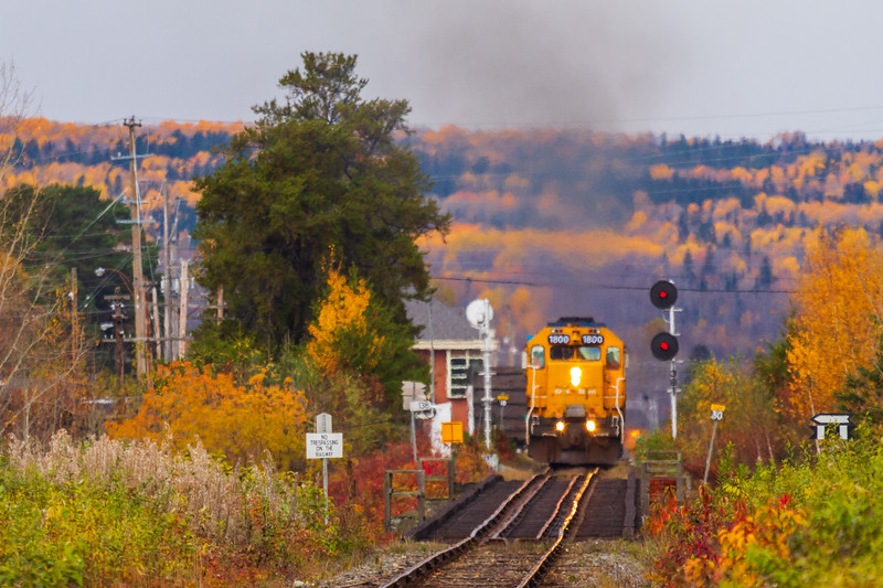 Ontario Northland Railway southbound Northlander passenger train leaving Englehart and about to cross the Englehart River 2010 October 11.