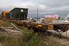 Ontario Northland freight car 100389 carrying metal bins near barge docks in Moosonee.