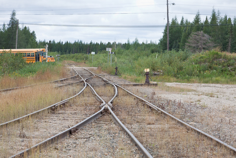 View of tracks crossing Bay Road and heading towards two legs of the wye in Moosonee.