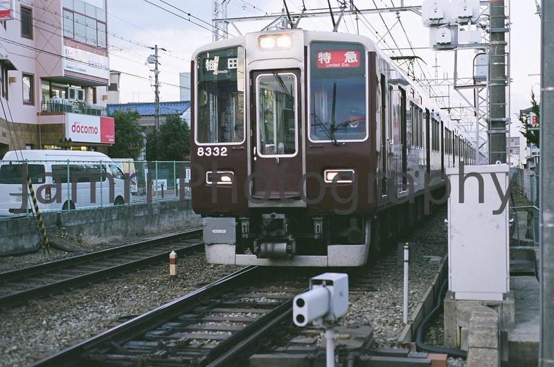 Hankyu Railway Commuter Train near station, Nagaokakyo, Kyoto-fu, Japan<br /> Date Taken: 01/03/2009<br /> Equipment/Film Used: Nikon F80, Nikkor AF 50 f/1.8D lens, Fujicolour PRO400 (PN400N)