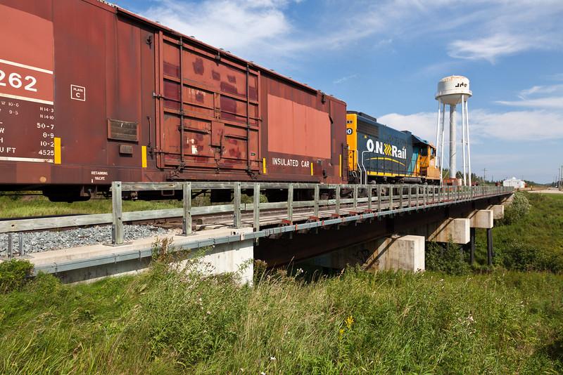GP38-2 1800 leads an Ontario Northland Railway freight across Store Creek and into Moosonee.