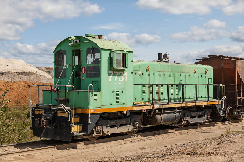 Visit to the Agrium Phosphate Mine near Kapuskasing. Remote controlled locomotive 7731 pulls train of phosphate cars as they are being loaded.