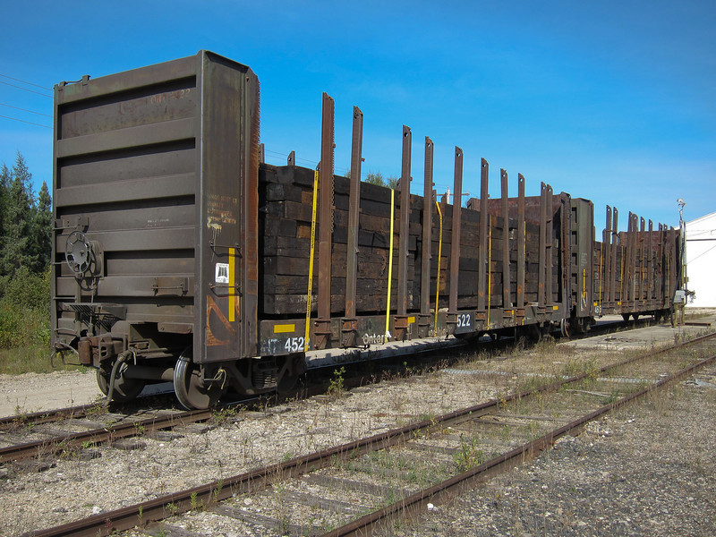 Ontario Northland bulkhead cars 4522 and 4516 loaded with ties at Moosonee.