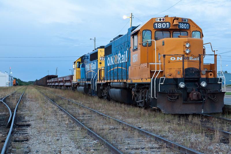 Ballast train in Moosonee led by GP38-2 1801 and GP40-2 2200.