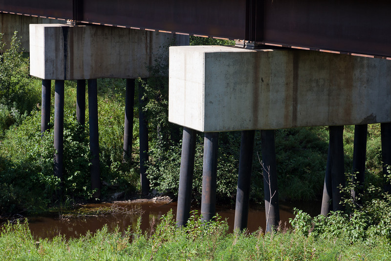Centre supports of Ontario Northland Railway bridge across Store Creek.