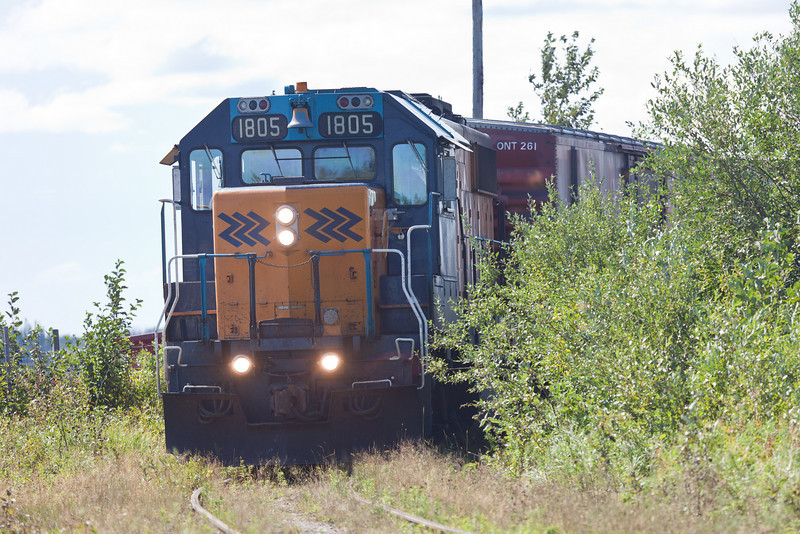 Ontario Northland Railway GP38-2 locomotive 1805 heads towards Airport Road in Moosonee after carrying out switching on tracks along the Moose River (Revillon Road) in Moosonee.