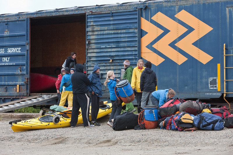 Canoeists loading their boats and baggage into a boxcar on the Polar Bear Express train.