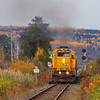 Ontario Northland Railway southbound Northlander passenger train crossing  the Englehart River 2010 October 11. Viewed from Kerr's Road.