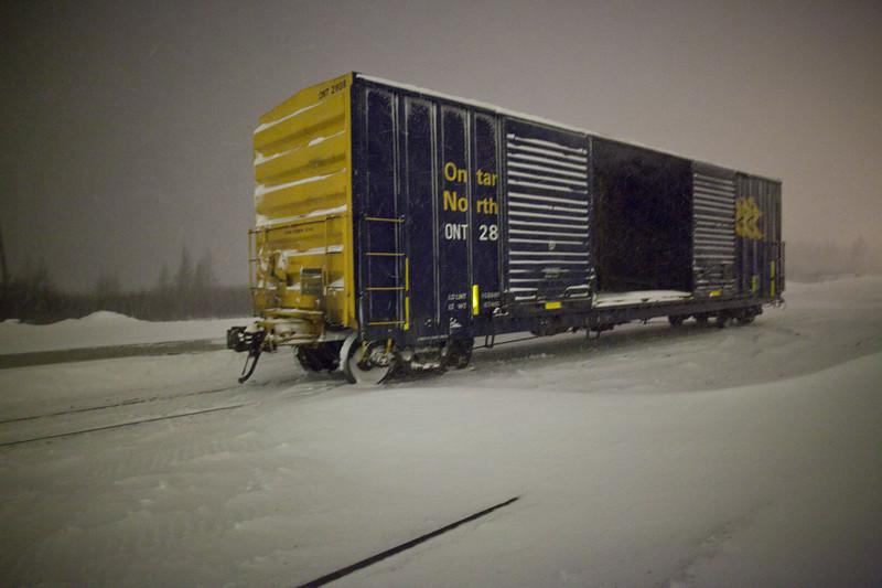 2010 December 14th snowstorm by night: Ontario Northland boxcar 2808.