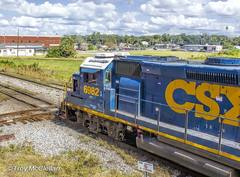 CSX 6982, GP40-2 leads an anhydrous ammonia train Northbound through the diamonds at Plant City, Florida