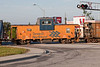 Caboose 1873 crossing highway in consist of gravel train