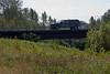 Hirail vehicle crossing Store Creek in Moosonee on Ontario Northland Railway