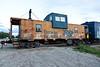 Ontario Northland Railway caboose 1873 at the end of ballast train in Moosonee.
