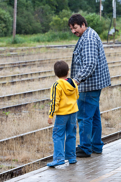 Holdlen with his grandfather Victor at the train station.