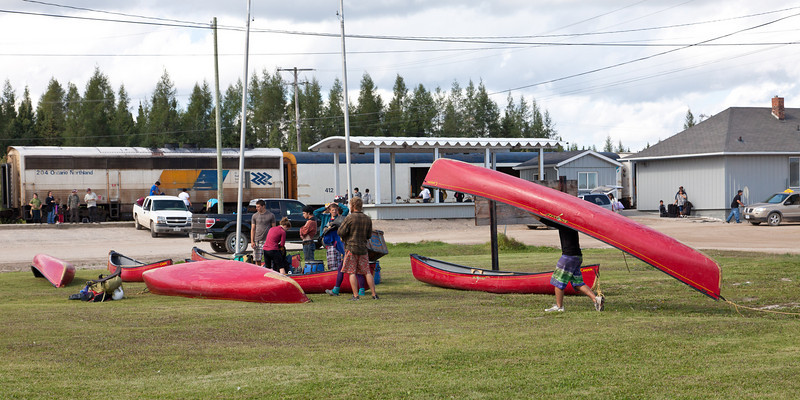 Canoeists arriving at Moosonee train station for the journey south. Canoes will be carried in a boxcar.