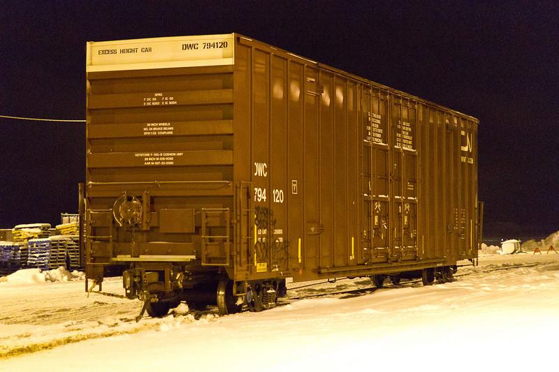 Boxcar DWC 794120 near barge docks on Revillon Road in Moosonee 2010 December 28th.