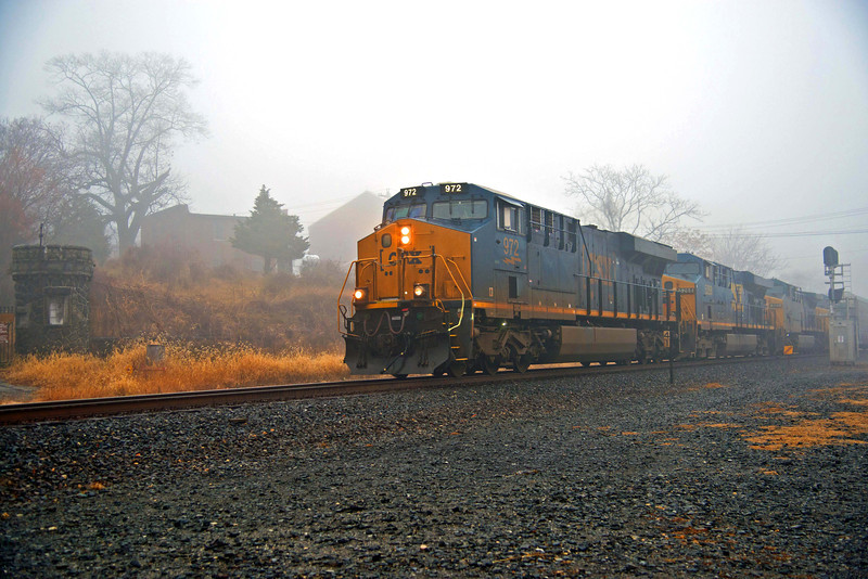 A foggy day and train showing gaurd house near entrance when it was a U.S military base, turned over to Bear Mt State Park in New York.