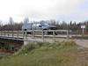 Ontario Northland Railway hirail vehicle crossing Store Creek in Moosonee.
