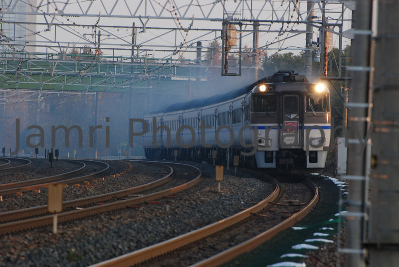 Old Diesel Train, Nagaokakyo, Kyoto-fu, Japan<br /> This old diesel train comes pass this spot every morning at the same time with a lot of exhaust.