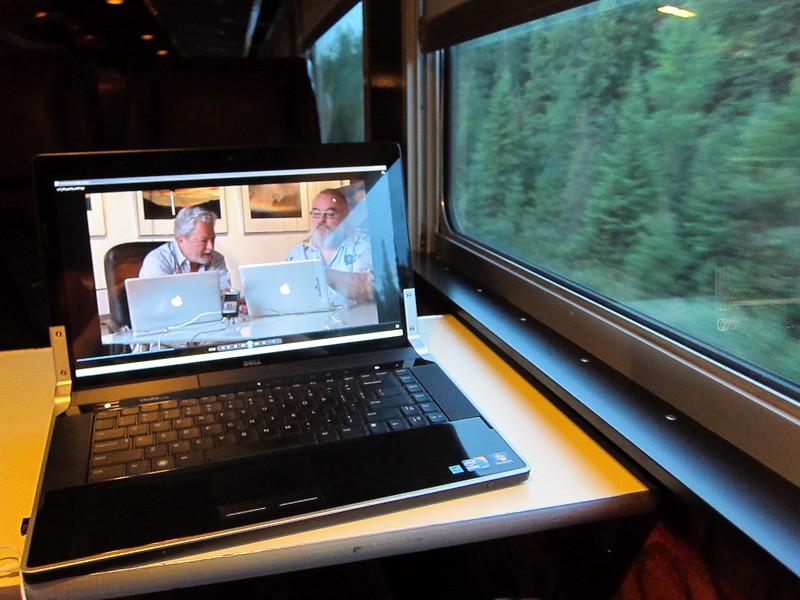 Using laptop on train. Luminous Landscape video about Lightroom 3.