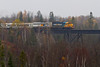 Ontario Northland GP38-2 locomotive 1800 leads the Northlander south across the Englehart River on a rainy day. 2010 October 13th.