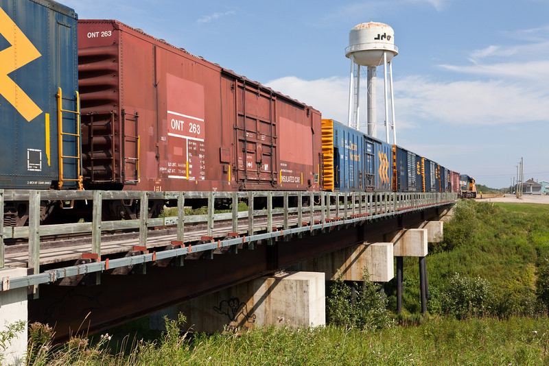GP38-2 1800 leads an Ontario Northland Railway freight across Store Creek and into Moosonee. Boxcars