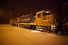 2010 December 14th snowstorm by night: Ontario Northland Railway locomotives GP38-2 1802 and 1801 with a load of ties at Moosonee.