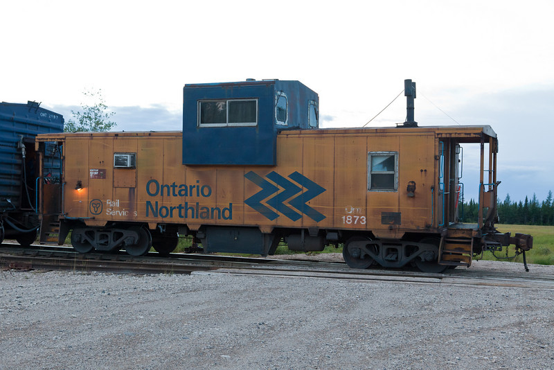 Caboose 1873 at Moosonee at the end of a ballast train. Ontario Northland Railway.