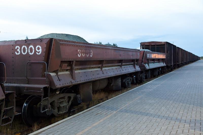 Air dump ballast car 3009 followed by a similar unit and then regular ballast cars.