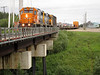 Ontario Northland Railway GP38-2 locomotives 1809 and 1802 wait to bring the Polar Bear Express train across Store Creek in Moosonee on its way to Cochrane, Ontario.