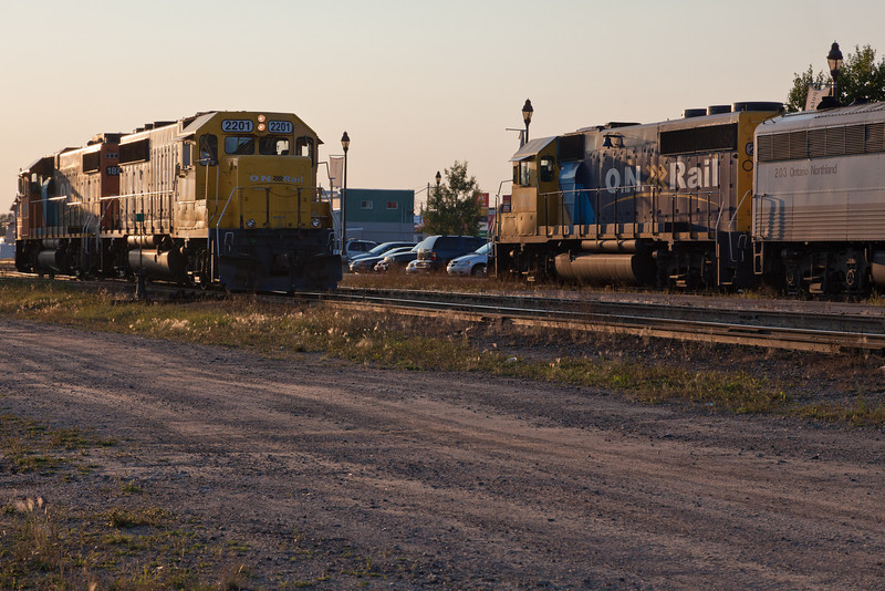 GP38-2 1804 and GP40-2 2201 pass the Northlander headed by GP40-2 2202 at Cochrane station.
