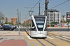 Tram 4401 built by Vossloh is seen crossing one of the major road junctions at Universitat Valencia 25/07/2012. This appeared to be brand new & was very comfortable to ride in & is seen on Line 4 to Dr Lluch. The styling on the front makes it look rather sad!. Understand this is a prototype by Vossloh.
