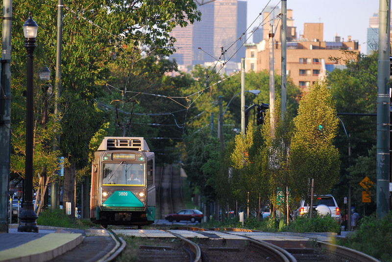 A type 8 Green Line Car arrives at Cooledge Corners in the Golden Hour.