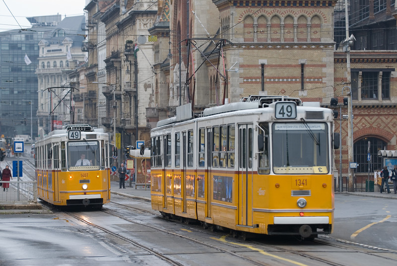 Trams in passing in front of Budapest's Nagycsarnok, or Great Market.